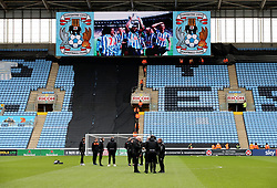 Blackpool players inspect the pitch ahead of the Sky Bet League One match at the  Ricoh Arena Coventry