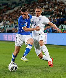 Alessandro Florenzi of Italy is challenged by Kieran Gibbs of England - Photo mandatory by-line: Rogan Thomson/JMP - 07966 386802 - 31/03/2015 - SPORT - FOOTBALL - Turin, Italy - Juventus Stadium - Italy v England - FIFA International Friendly Match.
