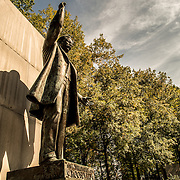 A sharp shadow is cast from the statue at the Theodore Roosevelt Memorial in Arlington, Virginia, just across the Potomac from the National Mall and Georgetown in Washington DC.