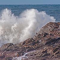Pacific Ocean waves roll ashore near Pescadero, California.