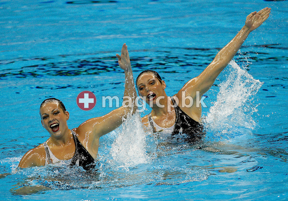 Mary Killman and Lyssa Wallace of the USA perform in the Synchronized (synchronised) Swimming Technical Duet preliminary round during the 14th FINA World Aquatics Championships at the Oriental Sports Center in Shanghai, China, Sunday, July 17, 2011. (Photo by Patrick B. Kraemer / MAGICPBK)