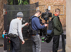 © Licensed to London News Pictures; 15/02/2021; Bristol, UK. OTTO FARRANT filming on location for Alex Rider with film crew wearing PPE during the coronavirus pandemic. Filming takes place in Bristol for the second series of Alex Rider, a British spy thriller streaming television programme based on the novel series of the same name by Anthony Horowitz. The film stars Otto Farrant as Alex Rider, who is recruited by a subdivision of MI6 as a teenage spy to infiltrate places that others are unable to. Filming the second series has  been delayed due to coronavirus. Photo credit: Simon Chapman/LNP.