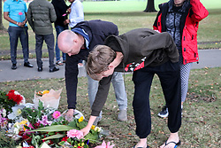 March 16, 2019 - Christchurch, Canterbury, New Zealand - People lay flowers to pay respect to the victims of the Christchurch mosques shooting. Around 50 people has been reportedly killed a terrorist attack onn two Christchurch mosques. (Credit Image: © Adam Bradley/SOPA Images via ZUMA Wire)