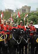 © Licensed to London News Pictures. 11/05/2012. Windsor, UK The Royal Canadian Mounted Police, who are at the show for the Jubilee Pagent, pictured in front of Windsor Castle, prepare to exercise their horses along the River Thames. The Royal Windsor Horse Show in Windsor, England on May 11 2012. Photo credit : Stephen Simpson/LNP