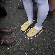 Participants in the march, Defenders of the Arctic drew around their feet as a symbolic defience against Shell's injunction on Greenpeace. The giant polar bear puppet Aurora made by Greenpeace walked the streets of London in defence of the Arctic as part of a Greenpeace global day of action. The parade,part performance part protest, was to highlight the melting ice caps and the increasing and potentially devastating oil drilling in the arctic sea. Shell is one of the companies drilling and the march through London ended up outside Shell London HQ to draw attention to their oil business in the arctic. Aurora, the biggest polar bear in the world represents all endangered species in arctic.