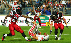 11.07.2011, UPC Arena, Graz, AUT, American Football WM 2011, Group B, Canada (CAN) vs Austria (AUT), im Bild catch for a touchdown from Jakob Dieplinger (Austria, #1, WR), Troy Adams (Canada, #21, DB) and Bryce McCall (Canada, #23, DB) cannot stop him // during the American Football World Championship 2011 Group B game, Canada vs Austria, at UPC Arena, Graz, 2011-07-11, EXPA Pictures © 2011, PhotoCredit: EXPA/ T. Haumer