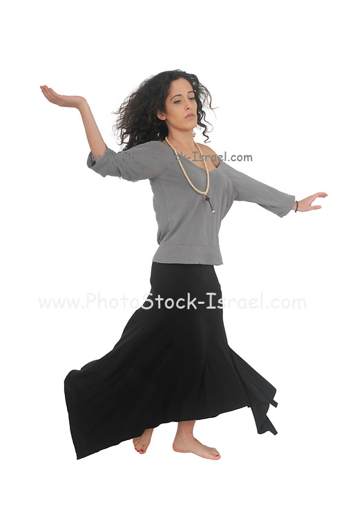 Whirling female Dervish style dancer on white background