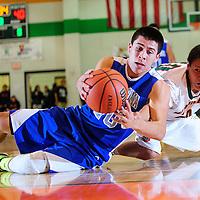 013113  Adron Gardner<br /> <br /> Laguna Acoma Hawk Austin Jones (20) grabs a loose ball on the floor ahead of Wingate Bear Kyle Jones (10) at Fort Wingate High School Thursday.