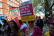 Solidarity with the Windrush Generation placard during May Day celebrations in London, England, United Kingdom. Demonstration by unions and other organisations of workers to mark the annual May Day or Labour Day. Groups from all nationalities from around the World, living in London gathered to march to a rally in central London to mark the global workers day.