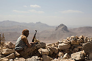 """Mcc0081437 . Daily Telegraph<br /> <br /> DT Foreign<br /> <br /> A Yemeni government soldier on the frontline in the Fardah mountains overlooking the village of Al Hatem on the road to the Houthi rebel held capital of Sanaa . <br /> <br /> Yemen has been in the midst of a civil war since 2015 when the President Abdrabbuh Mansur Hadi was forced to flee . A Saudi led coalition with 9 other Arab states  named """"Operation Decisive Storm """"  has since sought to restore Hadi with little effect .<br /> <br /> <br /> Yemen 22 February"""