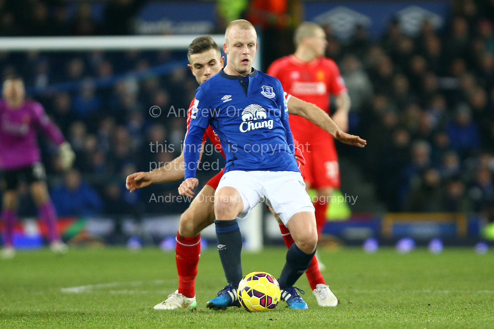 Steven Naismith of Everton shields the ball from Jordan Henderson of Liverpool. Barclays Premier league match, Everton v Liverpool at Goodison Park in Liverpool, Merseyside on Saturday 7th February 2015<br /> pic by Chris Stading, Andrew Orchard sports photography.