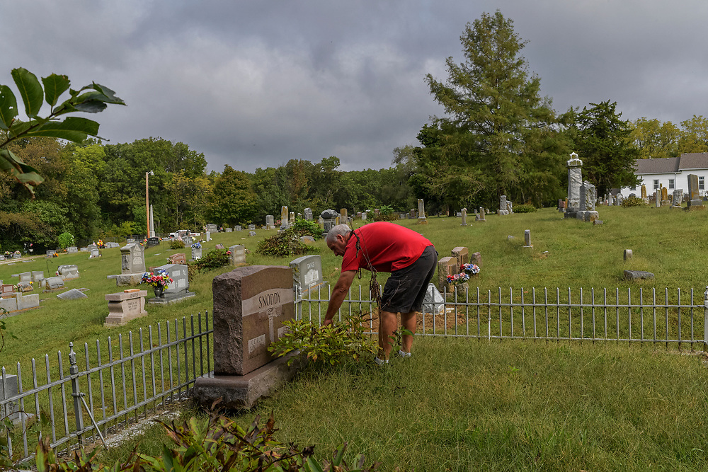 Jim Snoddy visits the grave of his great grandparents outside of Boonville.