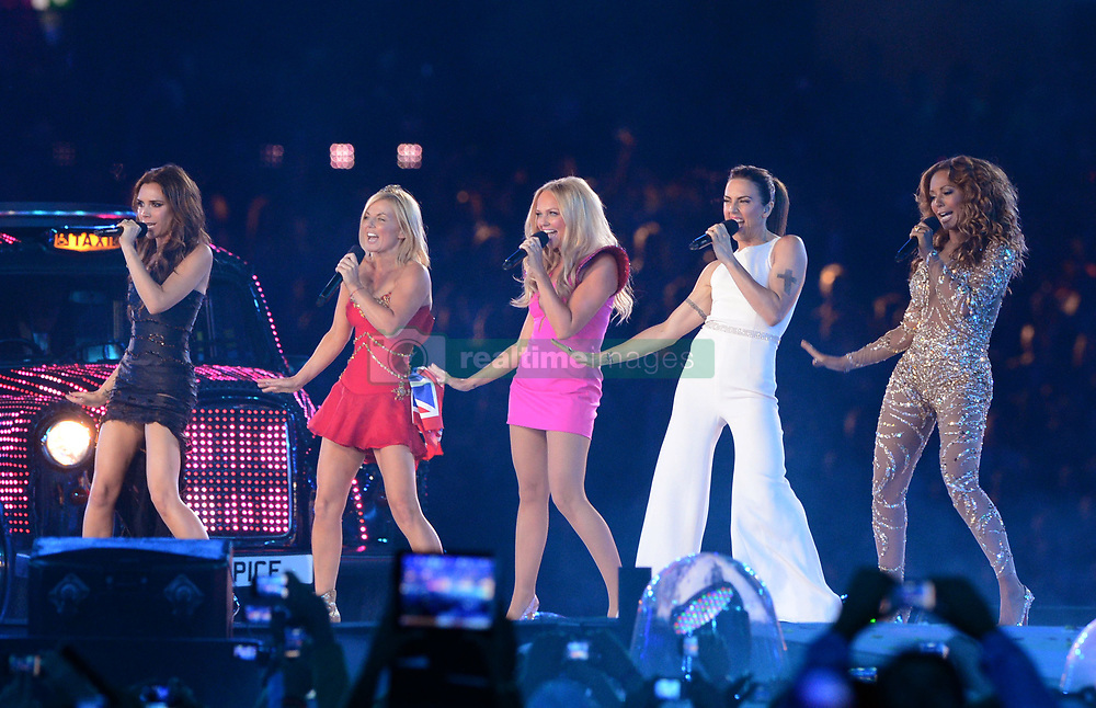 File photo dated 12/08/12 of The Spice Girls (left to right) Victoria Beckham, Geri Halliwell, Emma Bunton, Melanie Chisholm and Melanie Brown on stage. Bunton has confirmed plans for a Spice Girls animated superhero movie.