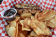 Chicken kabobs, with Teriyaki sauce on the side, and an order of home-made potato chips prepared at Jacobsmeyers Tavern in Granite City.
