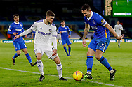 Leeds United midfielder Mateusz Klich (43) and Brighton and Hove Albion defender Lewis Dunk (5) in action during the Premier League match between Leeds United and Brighton and Hove Albion at Elland Road, Leeds, England on 16 January 2021.