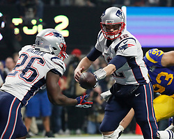 New England Patriots quarterback Tom Brady (12) hands off to running back Sony Michel (26) on their final scoring drive, which ended in a field goal, against the Los Angeles Rams during Super Bowl LIII at Mercedes-Benz Stadium in Atlanta on Sunday, February 3, 2019. The Patriots won, 13-3. Photo by Bob Andres/Atlanta Journal-Constitution/TNS/ABACAPRESS.COM