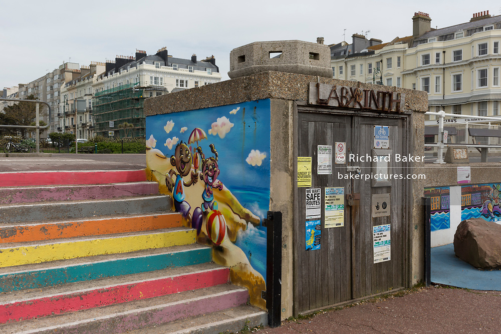 Old deckchair shed and more recent mural and coloured seafront steps, on 29th April 2017, at St Leonards, East Sussex, England.