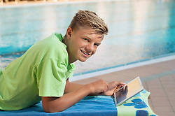 Swimming pool young male tablet computer portrait