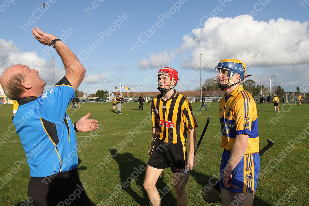Referee Kevin Walsh tosses the coin for the very last time as he retires from refereeing after to-day's minor A final watched by Captains Jack Browne Ballyea & Seadna Morey Sixmilebridge. - Photograph by Flann Howard