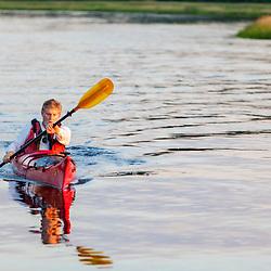 A man kayaking on the North River in Marshfield, Massachusetts. Near Emilson Farm.
