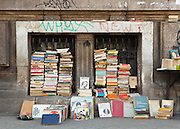 Piles of books stacked againt Bucharest Univerity Building, Secondhand bookseller, University Square, Bucharest