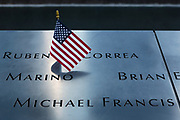 New York, NY - 7 September 2011. As the 20th anniversary of the attacks on the World Trade Center in New York approaches, people start to gather at the 9/11 Memorial site in lower Manhattan, sometimes leaving tributes. A small American flag in the name of Ruben D. Correa in the South Pool.
