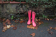 A pair of pink wellington boots (aka wellies) have been left outside a residential house in East Dulwich, on 12th December 2019, in south London, England.