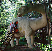 This brontosaur sculpture at Dinosaur Gardens Prehistoric Zoo outside Alpena, Michigan has a christian shrine within its belly.  The owner of the park, who made the sculptures also made a hero-sized sculpture of Jesus at the entrance.  At first he made the hands too big so he dynamited them off and replaced them.