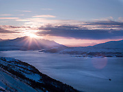 Ships sail down the Tromso Straits at sunset, seen from Mount Storsteinen in Tromso, Norway
