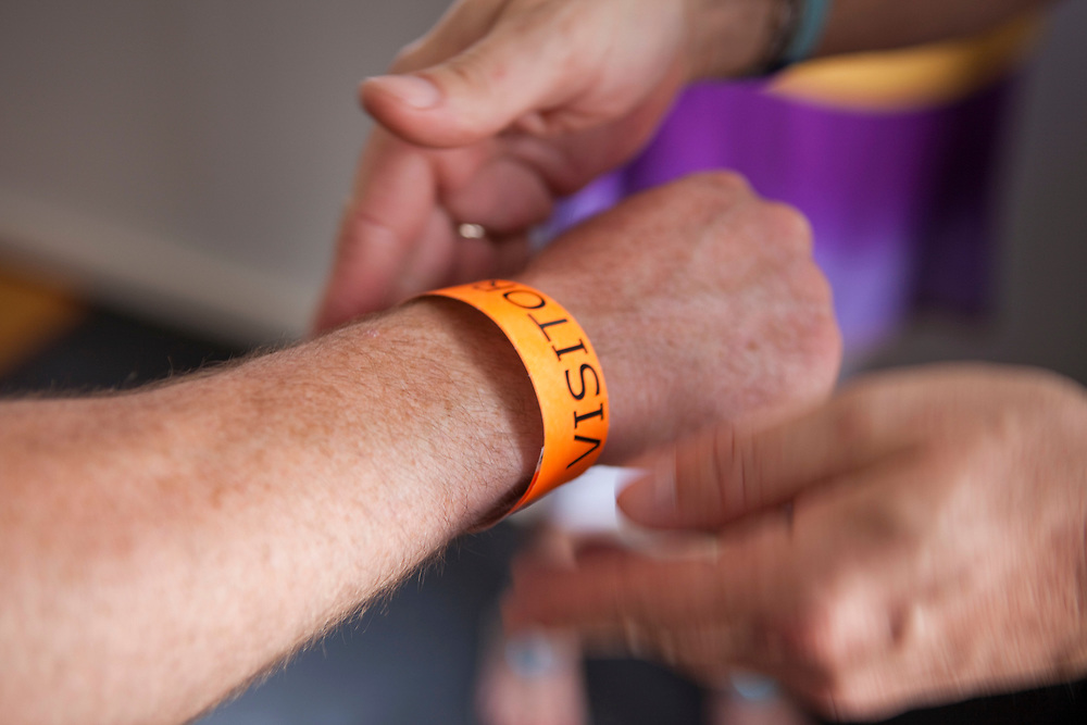 Visitors at HMP Kingston receive a visitor's wristband, which they must wear to distinguish them from the prisoners. Portsmouth, United Kingdom. Kingston prison is a category C prison holding indeterminate sentenced prisoners.