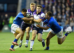 Huw Jones (second right) and Chris Harris of Scotland run into each other as the are sandwiched between Samoa's David Lemi (left) and Jack Lam (right)