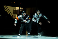 KELOWNA, CANADA - JANUARY 3: Referee Ryan O'Keefe and linesman Dustin Minty enter the ice at the start of the game between Kelowna Rockets and Tri-City Americans on January 3, 2017 at Prospera Place in Kelowna, British Columbia, Canada.  (Photo by Marissa Baecker/Shoot the Breeze)  *** Local Caption ***