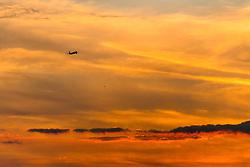 London Heathrow, September 19th 2015. An aircraft departs London Heathrow as the sunset sets the sky alight.