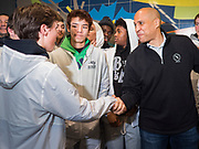 27 NOVEMBER 2019 - DES MOINES, IOWA: US Senator CORY BOOKER (D-NJ), right, talks to the Centennial High School basketball team after lunch at Central Iowa Shelter and Services in Des Moines. They had to bump elbows rather than shake hands because Sen Booker was wearing gloves to handle food. Sen Booker helped plate up and serve lunch at the shelter. The shelter has about 180 beds and is full almost every night. In January and February, more than 250 people per night come to the shelter, which sets out overflow bedding. Senator Booker is running to be the Democratic nominee for the US Presidency in 2020. Iowa hosts the first selection event of the presidential election season. The Iowa caucuses are February 3, 2020.         PHOTO BY JACK KURTZ