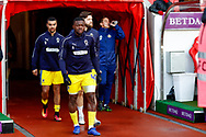 Wimbledon defender Adedeji Oshilaja (4) leads his team out for the warm up during the EFL Sky Bet League 1 match between Sunderland and AFC Wimbledon at the Stadium Of Light, Sunderland, England on 2 February 2019.