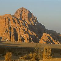 Sunset light glows on sandstone towers in the Wadi Rum, Jordan.