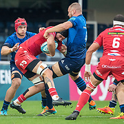 DUBLIN, IRELAND: October 16: Blade Thomson #8 of Scarlets is tackled by Ross Molony #4 of Leinster during the Leinster V Scarlets, United Rugby Championship match at RDS Arena on October 16th, 2021 in Dublin, Ireland. (Photo by Tim Clayton/Corbis via Getty Images)