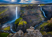 The waterfall Háifoss is situated near the volcano Hekla in the south of Iceland. The river Fossá, a tributary of Þjórsá, drops here from a height of 122 m. This is the third highest waterfall of the island.<br /> <br /> From the historical farm Þjóðveldisbærinn Stöng, which was destroyed by a volcanic eruption of Hekla in the Middle Ages and reconstructed, it is possible to hike to the waterfall along the Fossá (5 to 6 hours both directions). Above the waterfall, there is also a parking lot, so the hiking can also be made in the other direction.