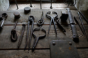 Tools used in the Forge at the Rogatec Open Air Museum, very close to the Croatian border, on 24th June 2018, in Rogatec, Slovenia. The museum of relocated and restored 19th and early 20th century farming buildings and houses represents folk architecture in the area south of the Donacka Gora and Boc mountains.