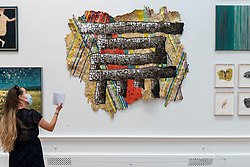 © Licensed to London News Pictures. 15/09/2021. LONDON, UK. 'DEXTERITY' by El Anatsui Hon RA, price Not For Sale. Preview of the Summer Exhibition 2021 at the Royal Academy of Arts in Piccadilly. Co-ordinated by Yinka Shonibare RA, the exhibition explores the theme of 'Reclaiming Magic' to celebrate the joy of creating art with around 1400 works by emerging and established artists featured in the exhibition.  The Summer Exhibition is the world's largest open submission contemporary art show and has taken place every year without interruption since 1769.  Photo credit: Stephen Chung/LNP