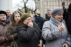 © Licensed to London News Pictures. 24/02/2014. Ukraine, Onlookers during protests in Kalush, western Ukraine, when Security Service of Ukraine and Party of Regions buildings were attacked. Photo credit : Christopher Nunn/LNP