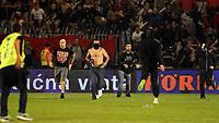 Fotball<br /> EM-kvalifisering<br /> Serbia v Albania<br /> 14.10.2014<br /> Foto: imago/Digitalsport<br /> NORWAY ONLY<br /> <br /> Ivan Bogdanov (left) one of main leaders of FC Red Star fans Delije run on the field during fights on FK Partizan stadium