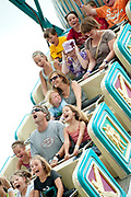PRICE CHAMBERS / NEWS&GUIDE<br /> Carnival goers scream, cringe and smile as they ride Pharoh's Fury at the Teton County Fair midway Saturday.