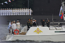 July 30, 2017 - Saint-Petersburg, Russia - Of The Russian Federation. Saint-Petersburg. The main naval parade of Russia in honor of Navy day. Day of the Navy. The Waters Of The Neva River. Russia's armed forces..The President of the Russian Federation Vladimir Vladimirovich Putin and Defense Minister Sergei Shoigu. (Credit Image: © Russian Look via ZUMA Wire)