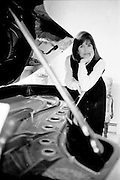 Joan Yogg at the piano