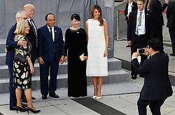 (left to right) Lucy Turnbull and her husband Australian Prime Minister Malcolm Turnbull, US President Donald Trump, Vietnamese Prime Minister Nguyen Xuan Phuc and his wife Tran Nguyet, and Melania Trump have their picture taken as they arrive to attend a concert at the Elbphilharmonie concert hall in Hamburg.