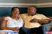 Johnny Lewis and his wife, Shirley, joke around at their home in Fort Worth, Texas on April 21, 2014. Johnny is the caretaker for Shirley who has been diagnosed with ALS. (Cooper Neill / for AARP)