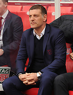 West Ham manager Slaven Bilic  looks on from his seat in the dugout. Premier league match, Stoke City v West Ham Utd at the Bet365 Stadium in Stoke on Trent, Staffs on Saturday 29th April 2017.<br /> pic by Bradley Collyer, Andrew Orchard sports photography.