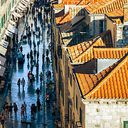 """Tourists and locals strolling down one of the main streets within the walled old city of Dubrovnik, Croatia. <br /> <br /> Dubrovnik serves as the official setting of """"King's Landing"""" from the popular TV show """"Game of Thrones""""."""