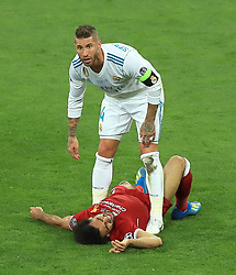 File photo dated 26-05-2018 of Real Madrd's Garcia Sergio Ramos stands over Liverpool's Mohamed Salah after a challenge during the UEFA Champions League Final at the NSK Olimpiyskiy Stadium, Kiev.